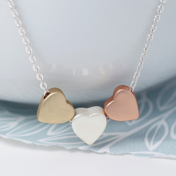 Triple heart necklace in silver, gold and rose gold finishes | Image 1