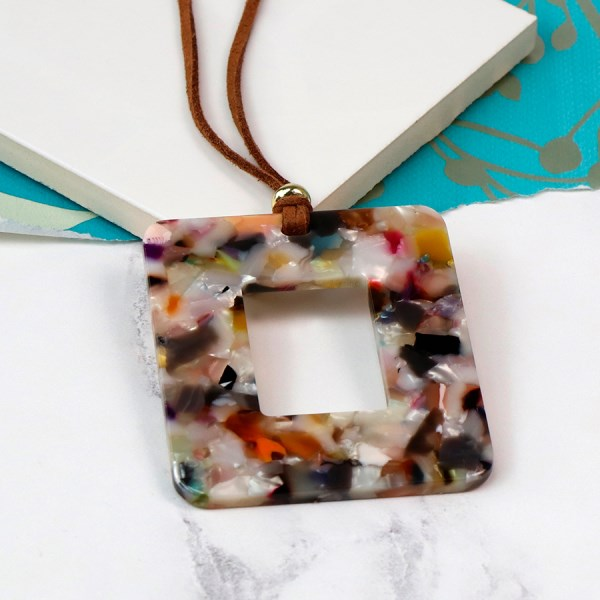 Multicoloured resin pendant on a long taupe cord | Image 1