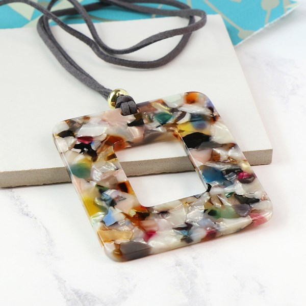 Multicoloured resin pendant on a long grey cord | Image 1