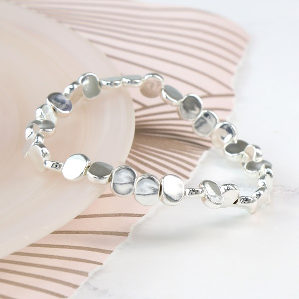 Silver plated stretch bracelet with flattened beads | Image 1