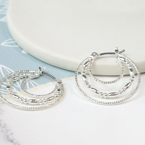 Silver plated triple layer decorative hoop earrings | Image 1