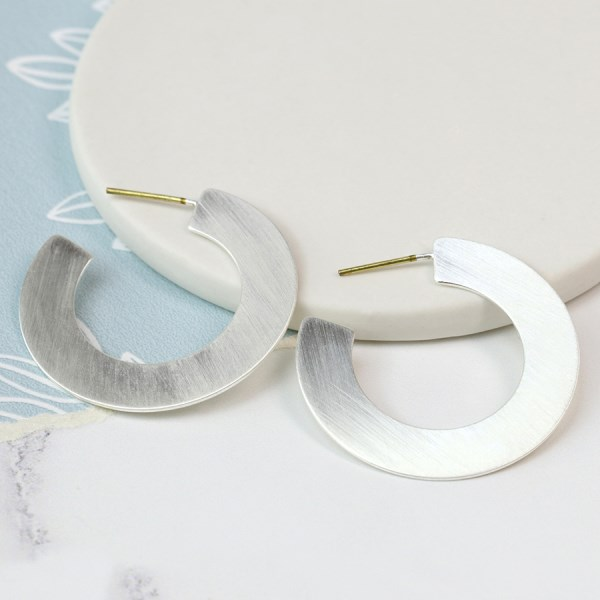 Silver plated open hoop earrings in a brushed finish | Image 1