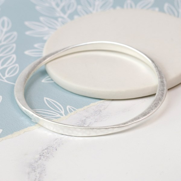 Silver plated tapered bangle in a worn finish | Image 1
