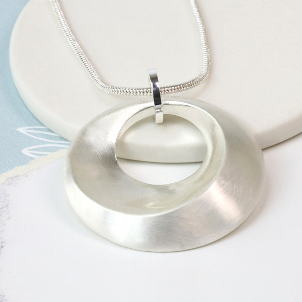 Silver plated swirl necklace in a worn finish | Image 1