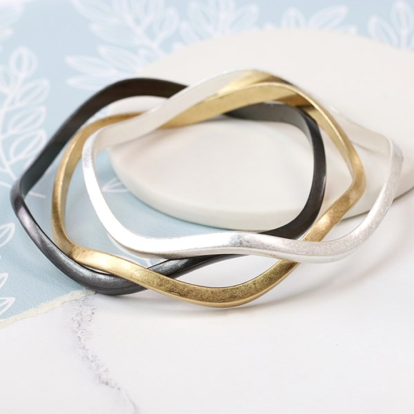Mixed metallic triple wave bangle set in a worn finish | Image 1