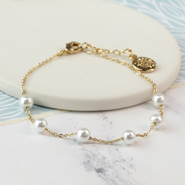 Gold plated chain and white faux pearl bracelet | Image 1
