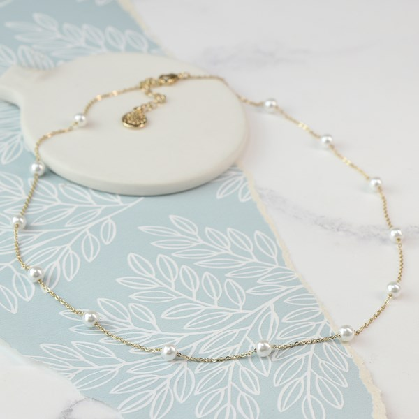 Gold plated fine chain necklace with white faux pearls | Image 1