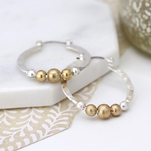 Silver plated textured hoop earrings with golden beads | Image 1
