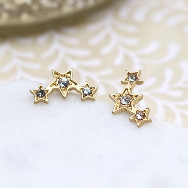 Gold plated triple star earrings with crystals and a worn finish | Image 1