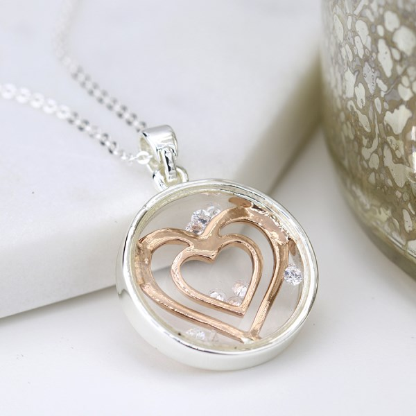 Circle necklace with enclosed rose gold hearts and crystals | Image 1