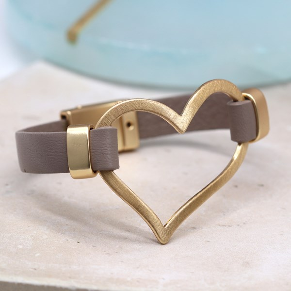 Taupe leather bracelet with a large scratched golden heart | Image 1