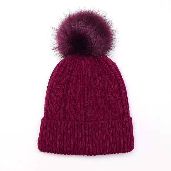 Wool mix cable knit hat in magenta with a matching faux fur bobble | Image 1