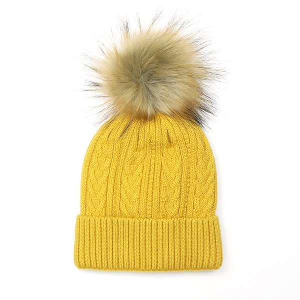 Winter hat in mustard yellow with a natural faux fur pom pom | Image 1