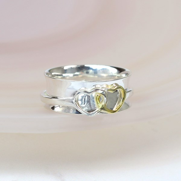 Sterling silver linked hearts spinning ring with gold | Image 1