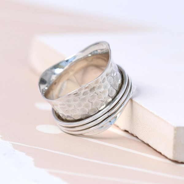Sterling silver hammered ring with triple moving bands | Image 1