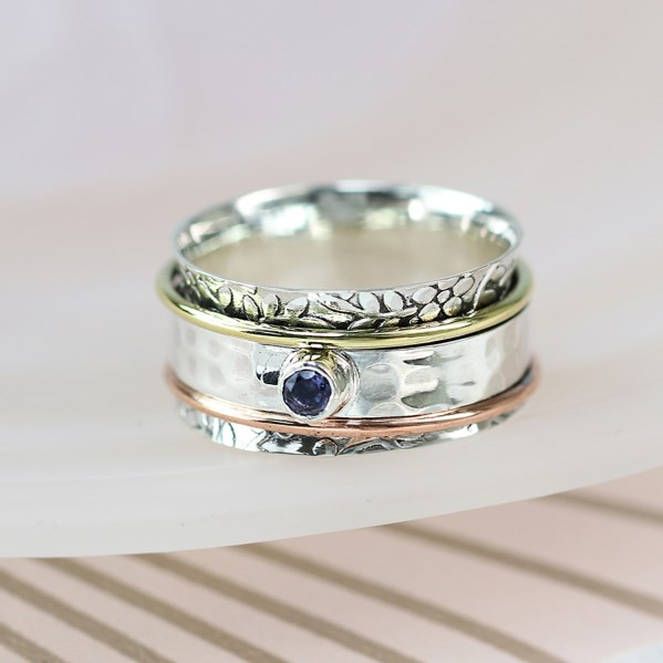 Sterling silver floral spinning ring with Iolite | Image 1
