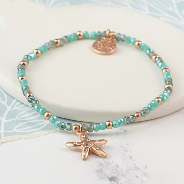 Aqua bead bracelet with a rose gold crystal starfish | Image 1