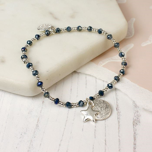Silver plated blue bead bracelet with star charm and disc | Image 1