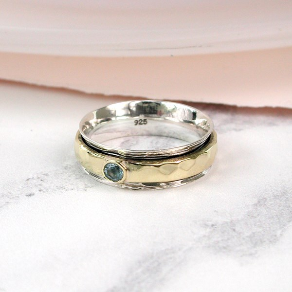 Sterling silver, brass and blue topaz spinning ring | Image 1