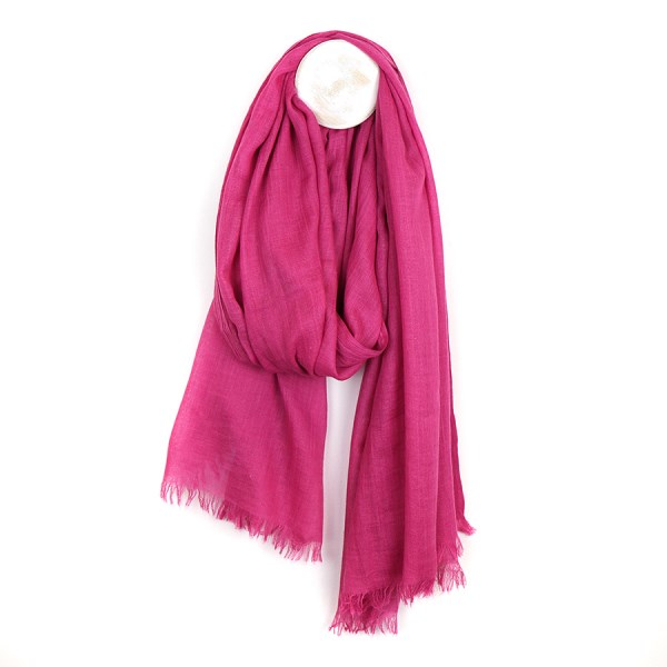 Vibrant pink lightweight scarf with gentle fraying at the ends | Image 1