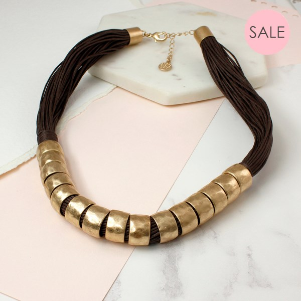 Multi strand dark cord and chunky golden rings necklace | Image 1