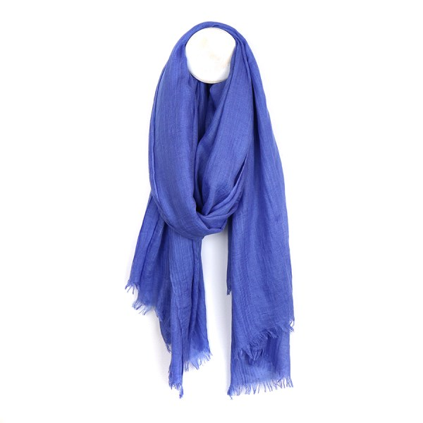 Plain lightweight scarf in cornflower blue with lightly frayed ends | Image 1