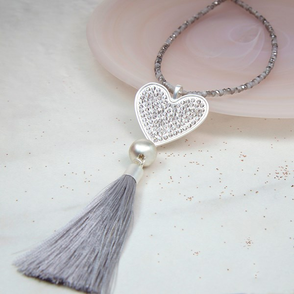 Long bead necklace with a crystal heart and grey tassel | Image 1