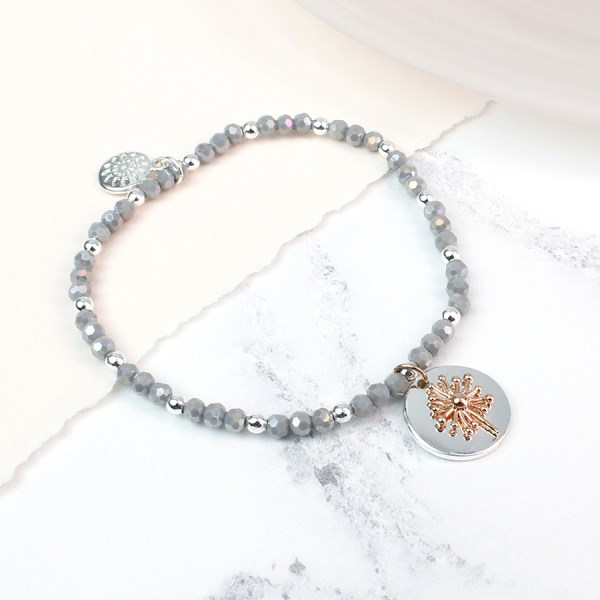 Grey bead bracelet with a rose gold dandelion clock charm | Image 1