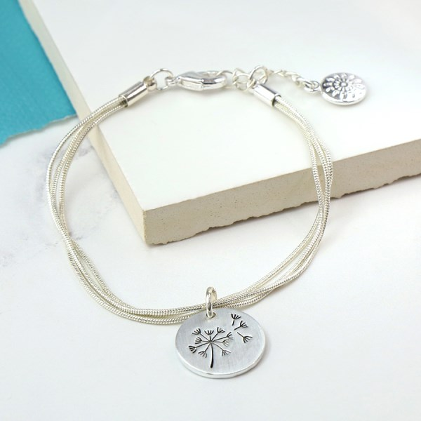 Silver plated triple strand bracelet with a dandelion disc | Image 1