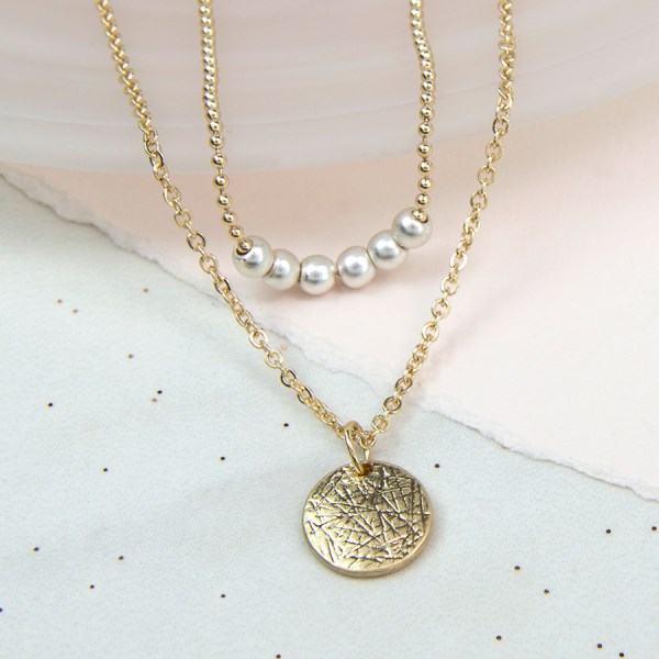 Gold plated textured disc and ivory pearl layered necklace | Image 1