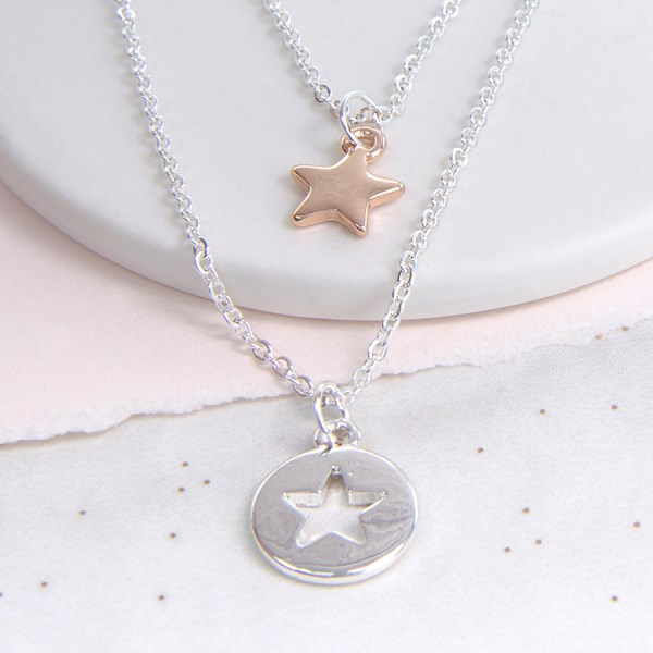Silver plated star disc and rose gold star layered necklace | Image 1
