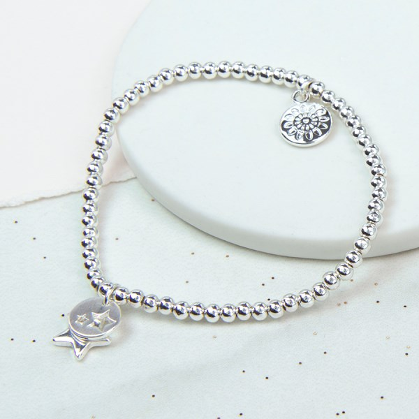 Silver plated bracelet with star charm and star disc | Image 1