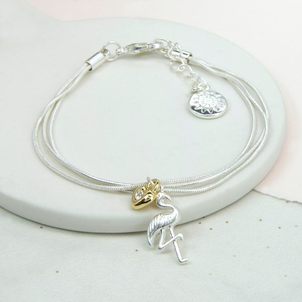 Silver plated bracelet with flamingo and heart charms | Image 1