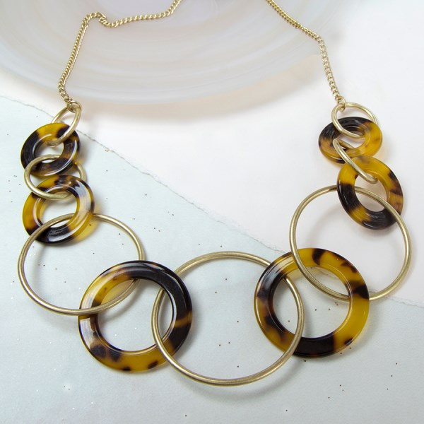 Worn gold and tortoise shell acrylic hoops necklace | Image 1