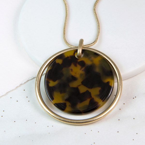 Worn gold and acrylic tortoise shell disc necklace | Image 1