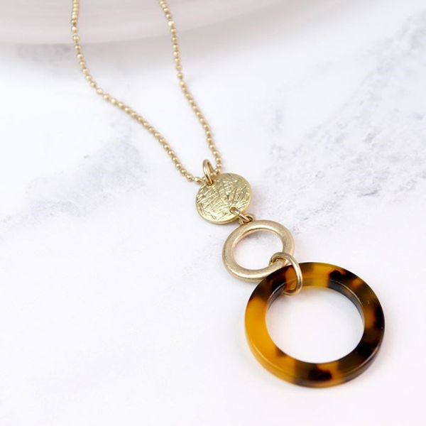 Long gold plated necklace with tortoise shell hoop | Image 1