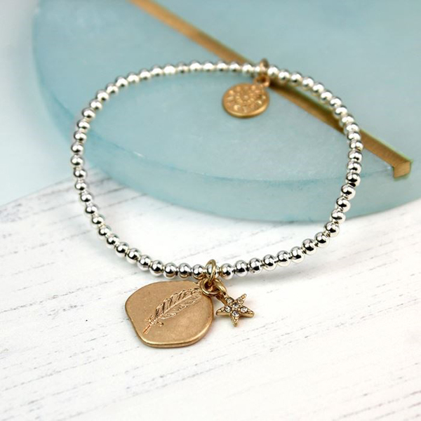 Gold plated feather imprint and star charm bracelet | Image 1