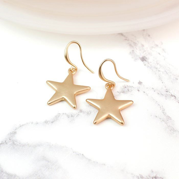 Gold plated star drop earrings with a matt finish | Image 1