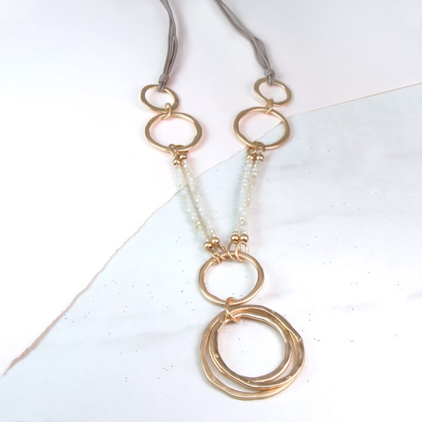 Long golden multi hoop necklace with beads | Image 1