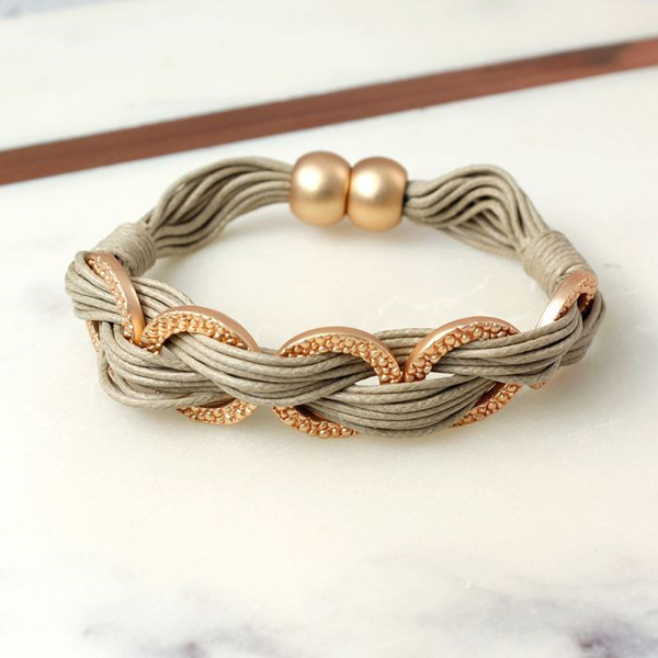Multi strand taupe bracelet with textured rose gold rings | Image 1