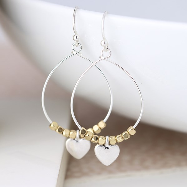 Worn silver teardrop earrings with golden beads and heart | Image 1