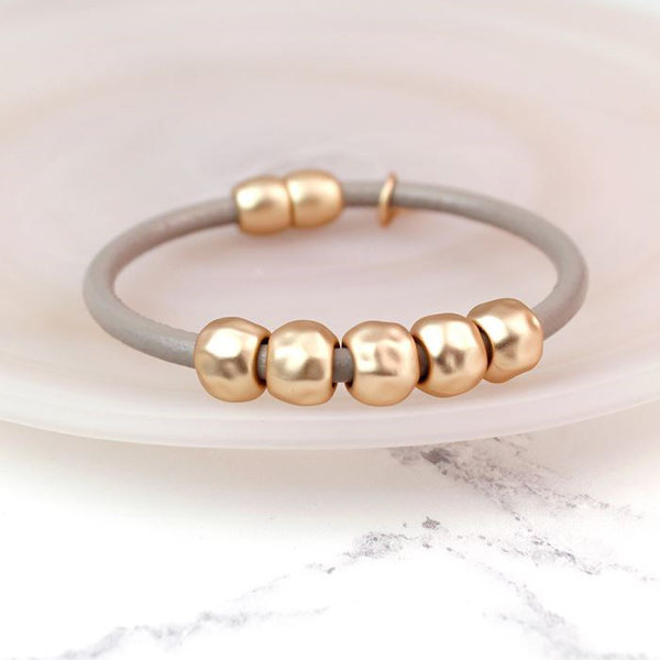 Taupe leather bracelet with matt gold plated beads | Image 1