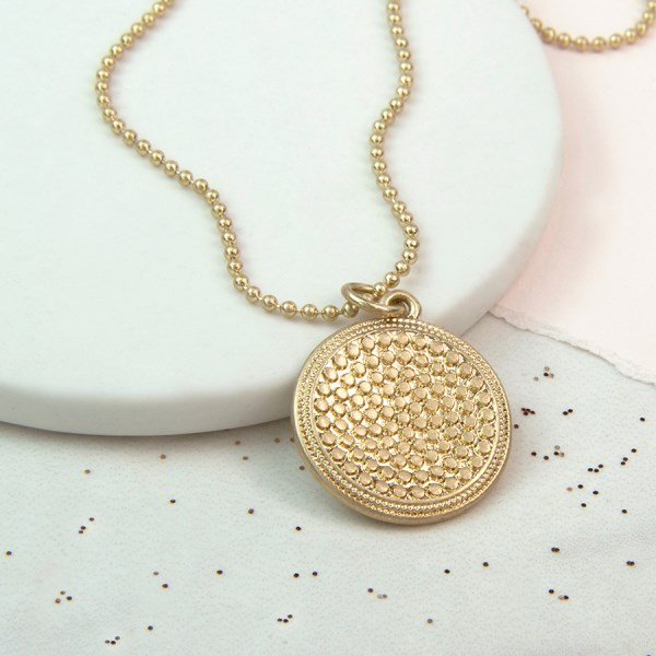 Gold plated studded disc necklace in a worn finish | Image 1