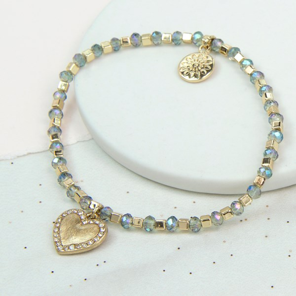 Gold and pale blue bead bracelet with golden crystal heart | Image 1