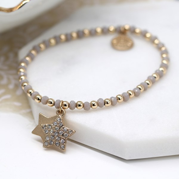 Gold and grey bead bracelet with double star and crystal charms | Image 1