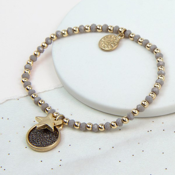 Golden glitter disc and star bracelet with grey beads | Image 1