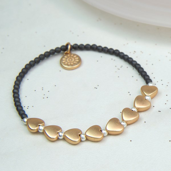 Grey bead bracelet with golden matt hearts and silver beads | Image 1