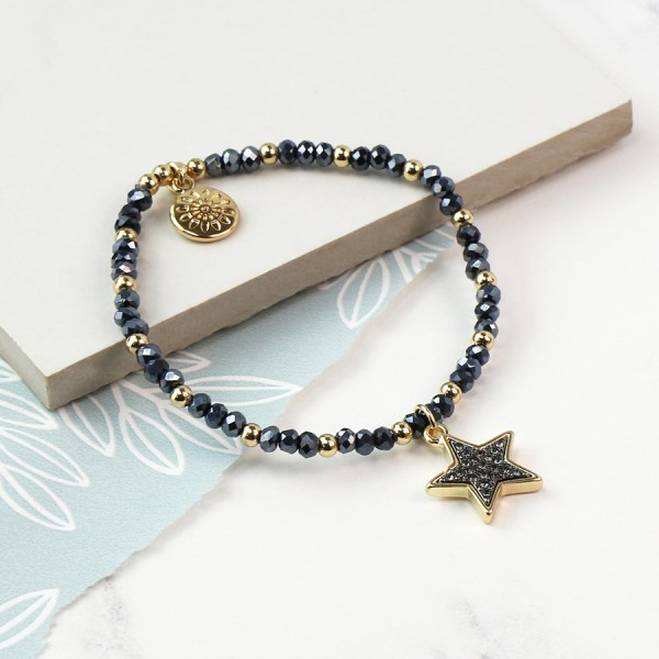 Dark bead and golden star bracelet with sparkle centre | Image 1