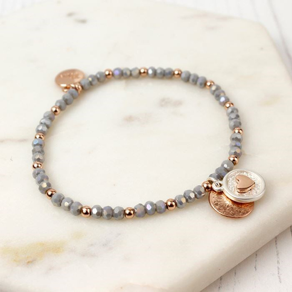 Grey bead bracelet with a rose gold heart disc charm | Image 1