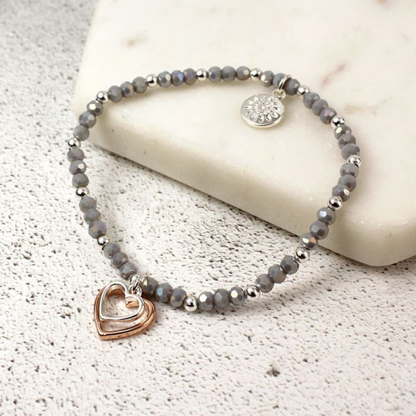 Grey bead bracelet with silver and rose gold hearts | Image 1
